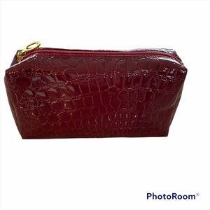 Estée Lauder red cosmetic bag. Gold tag on zipper